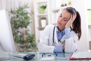 young doctor in a stressful situation has a headache